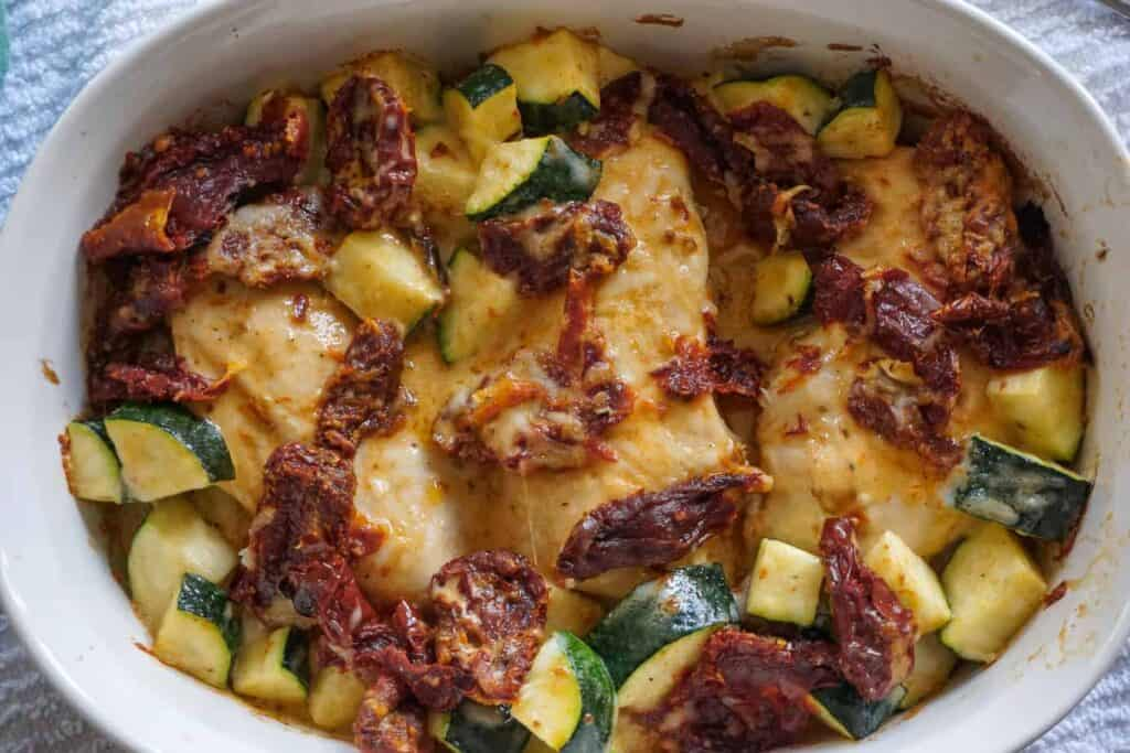 Creamy Tuscan Chicken Casserole with sun-dried tomatoes and zucchini