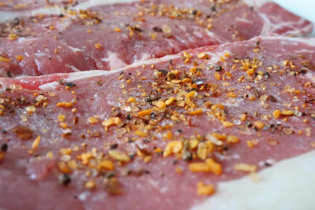 ribeye steak before cooking with seasonings