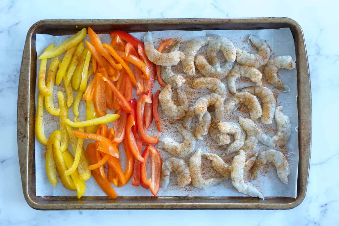 shrimp fajitas with seasoning, guacamole and cilantro before cooking