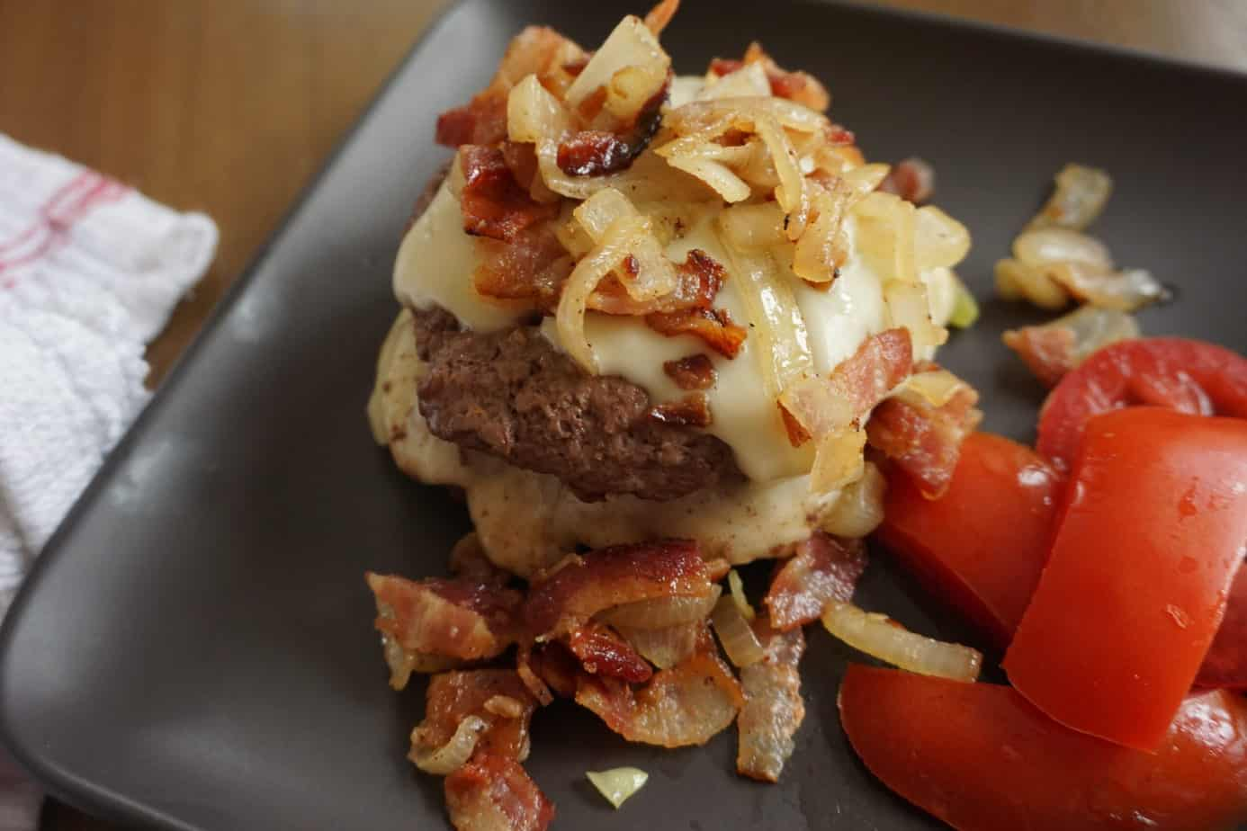 burger covered in cheese and bourbon bacon jam