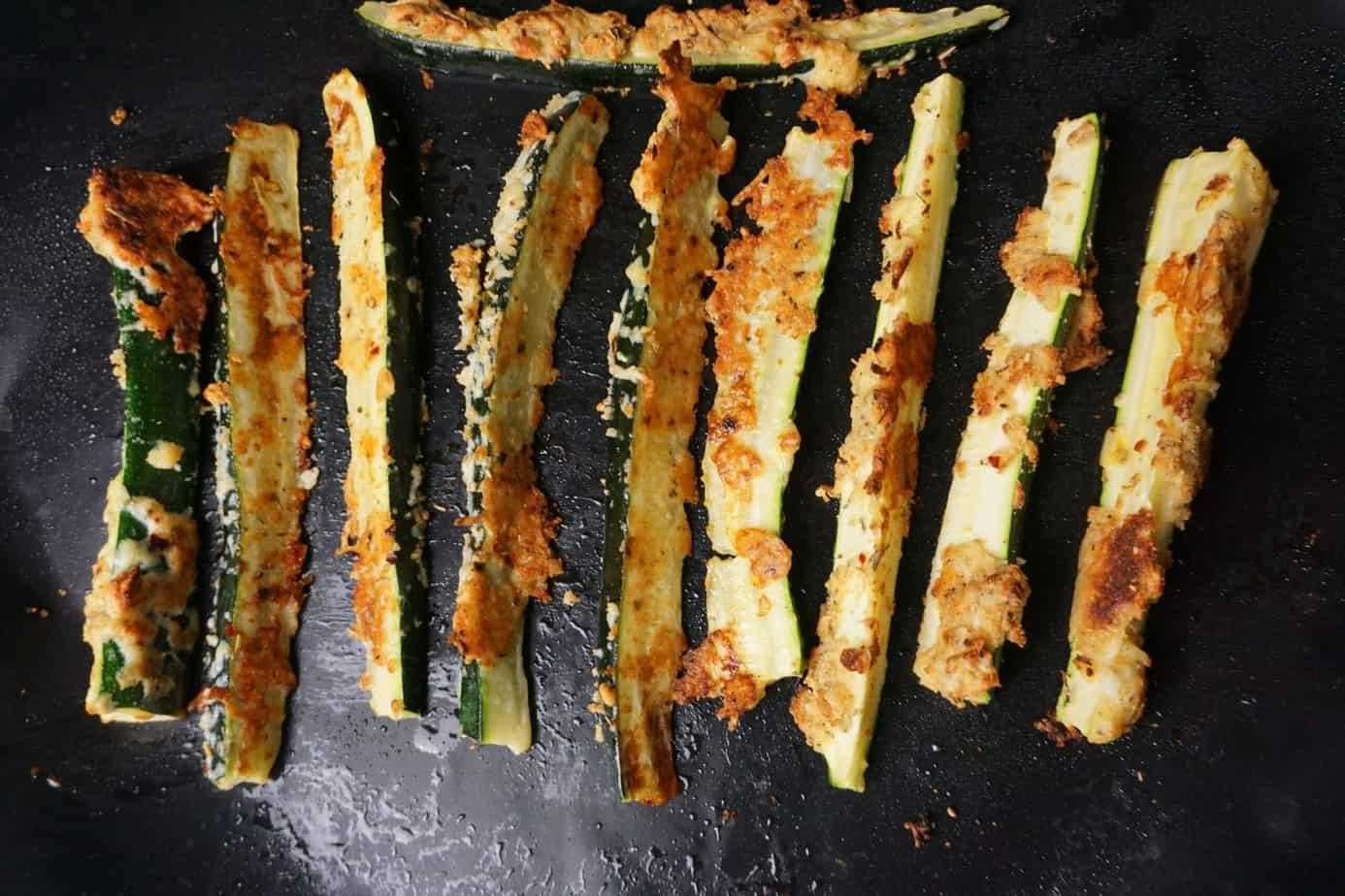 crisp zucchini fries on a baking sheet