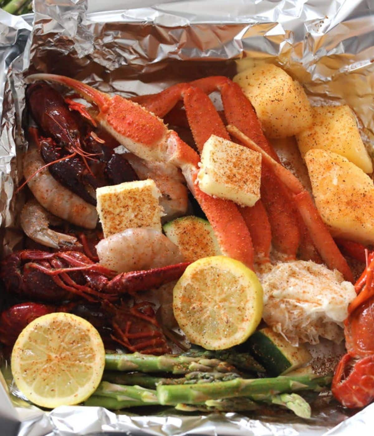 cajun lemon butter with crab legs and asparagus