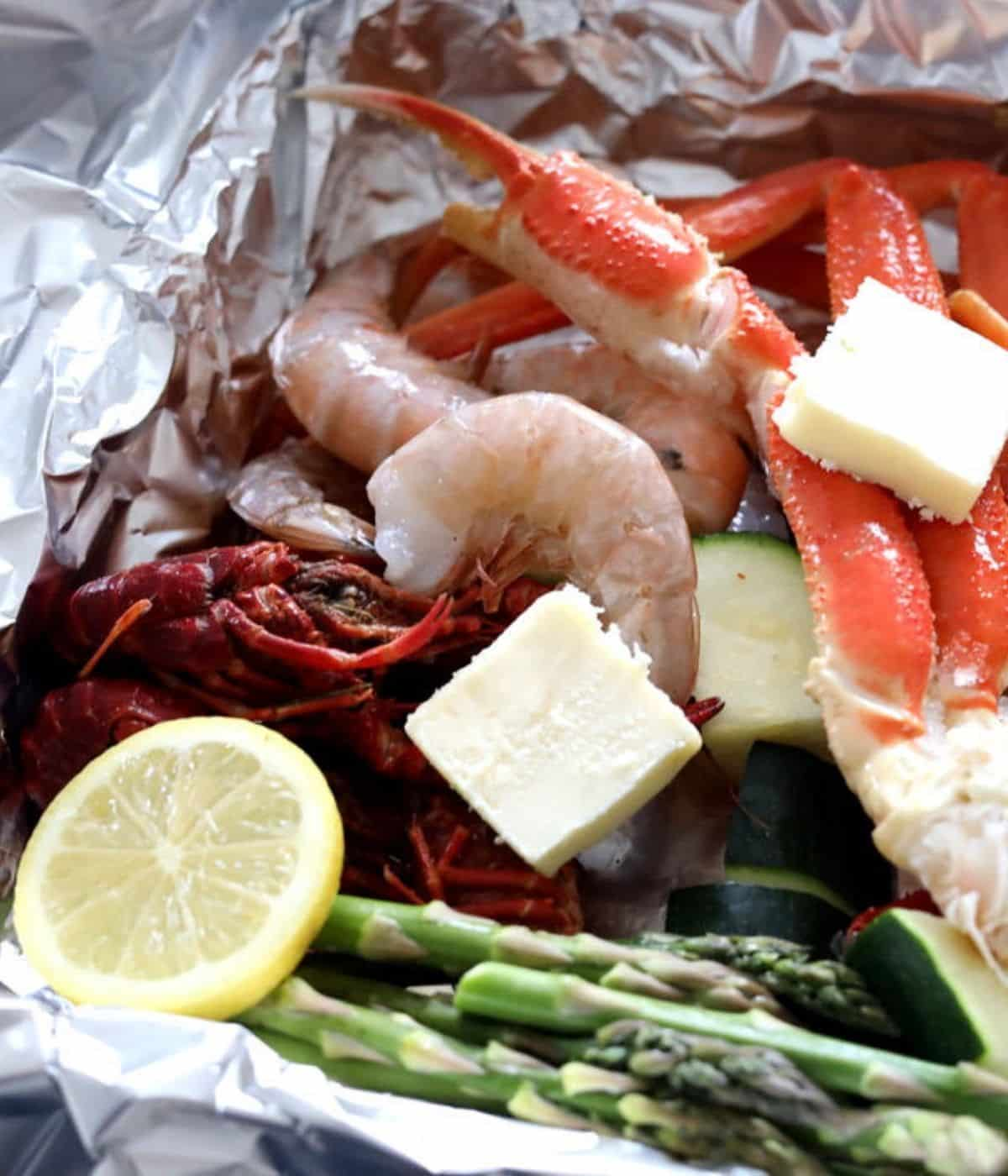 foil with seafood veggies and butter