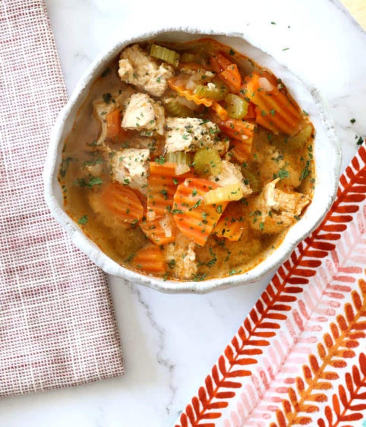 homestyle turkey soup with carrots in a bowl