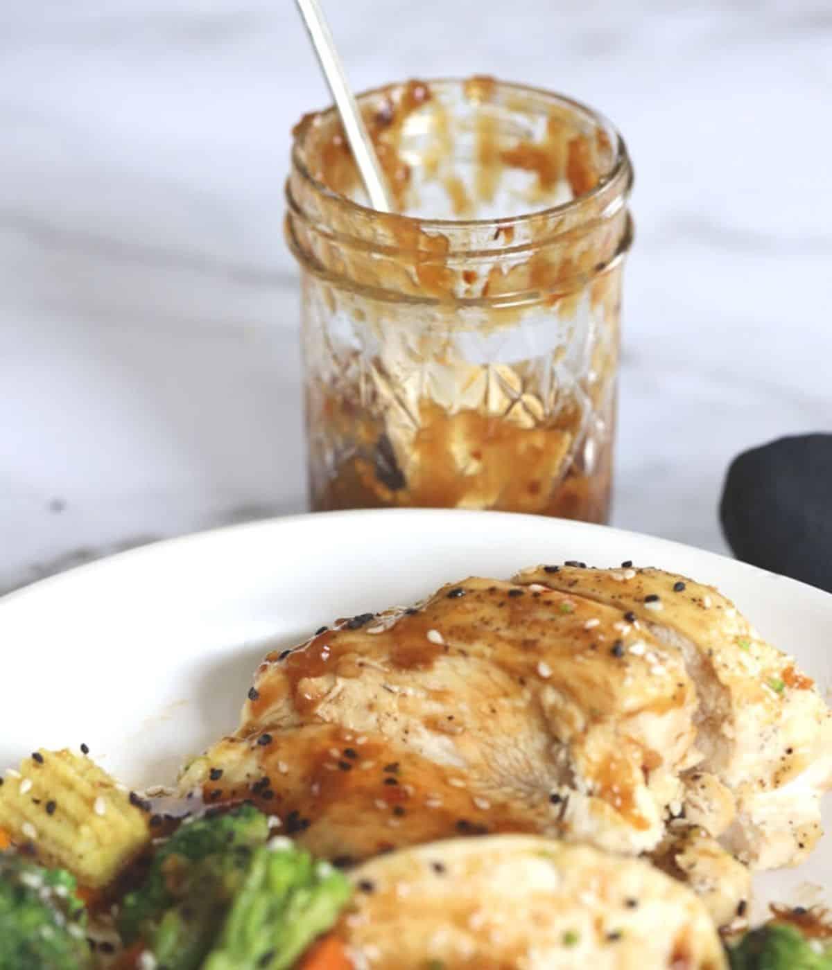 jar of sauce with stir fry chicken