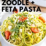 zucchini pasta with feta cheese crumbles and ripe cherry tomatoes