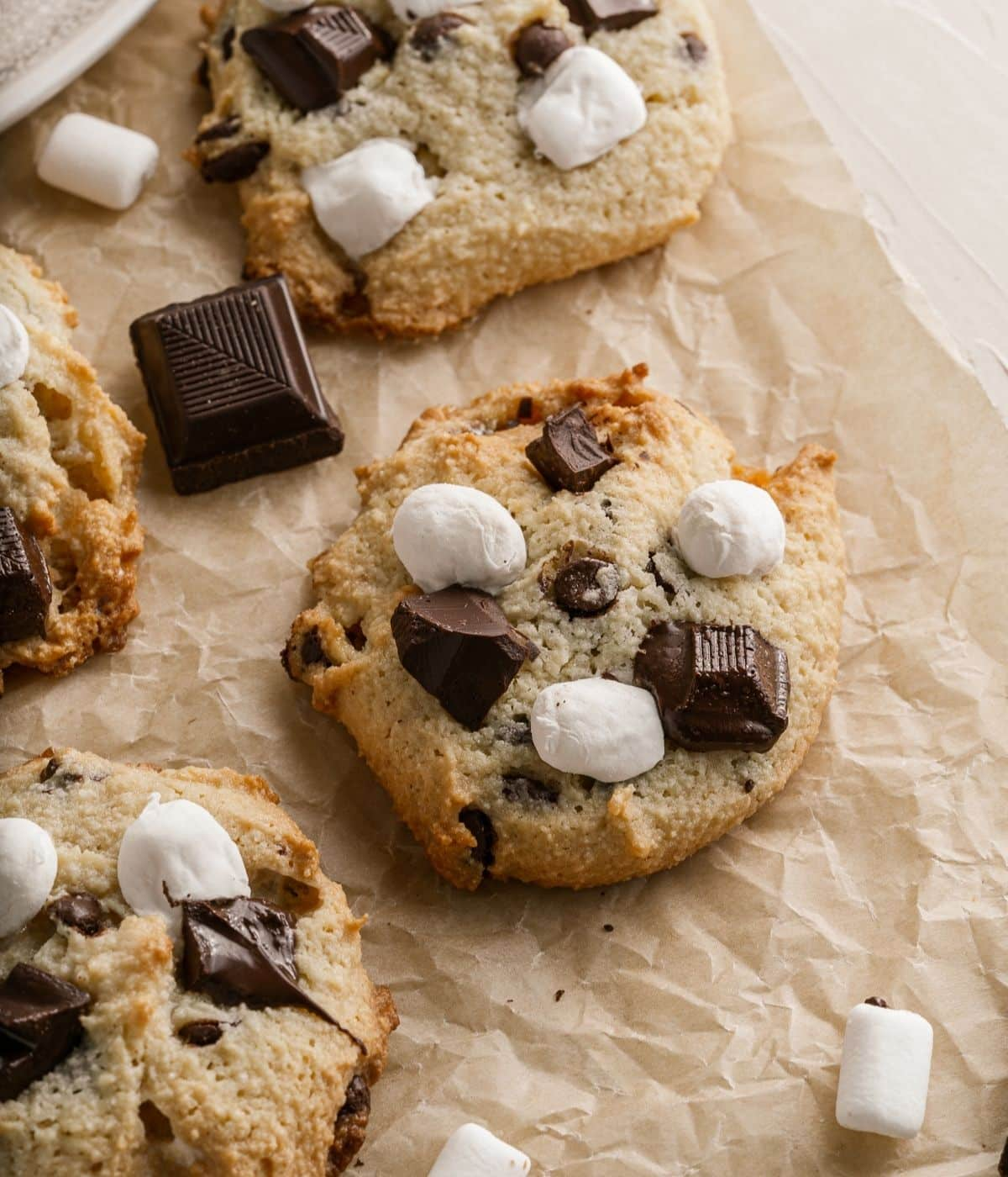 smores cookies on a baking sheet with chocolate and marshmallows