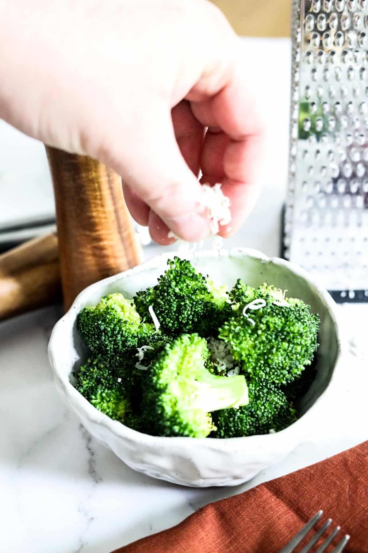 adding toppings to broccoli