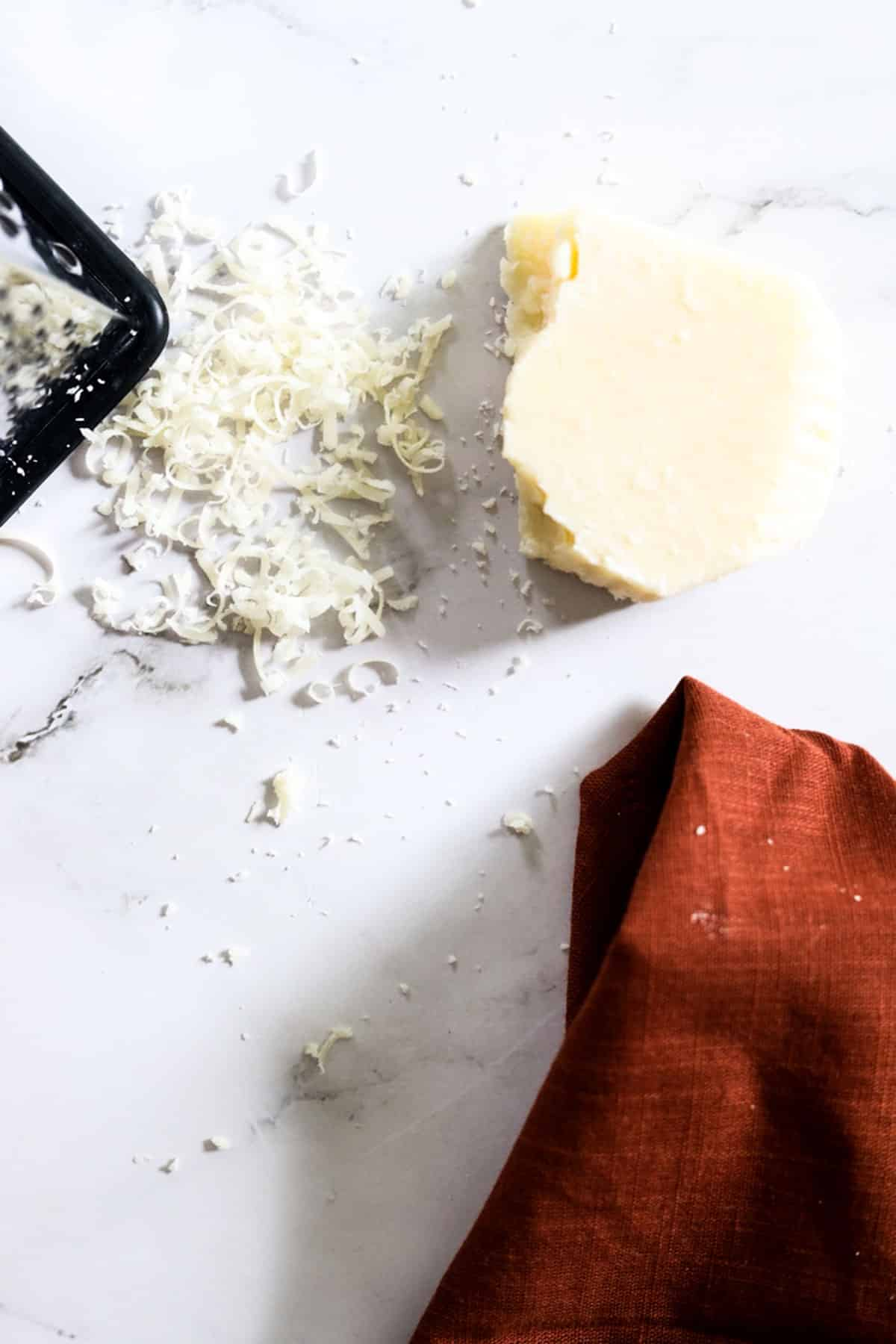 parmesan cheese with napkin and grater