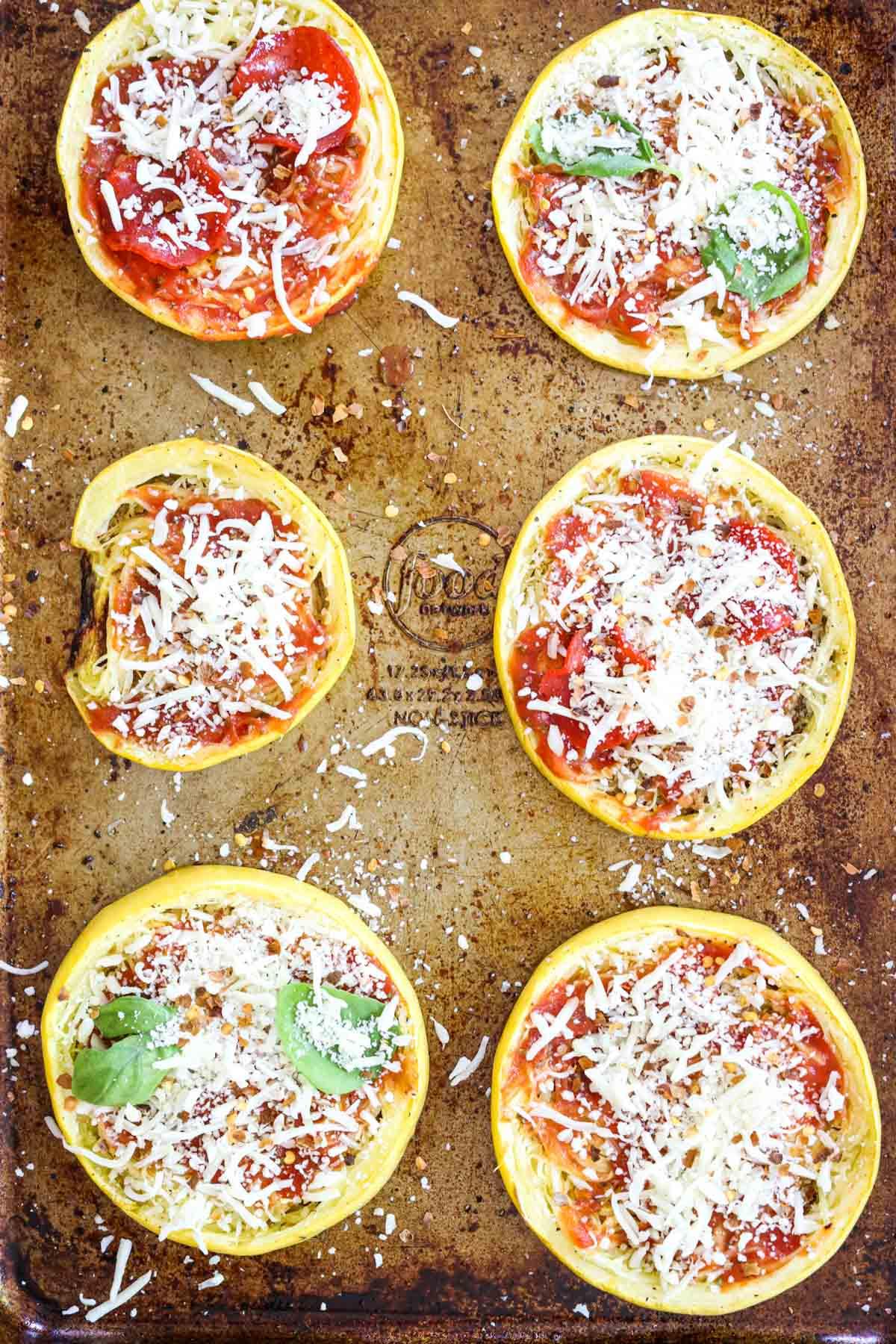 adding toppings to spaghetti squash pizza