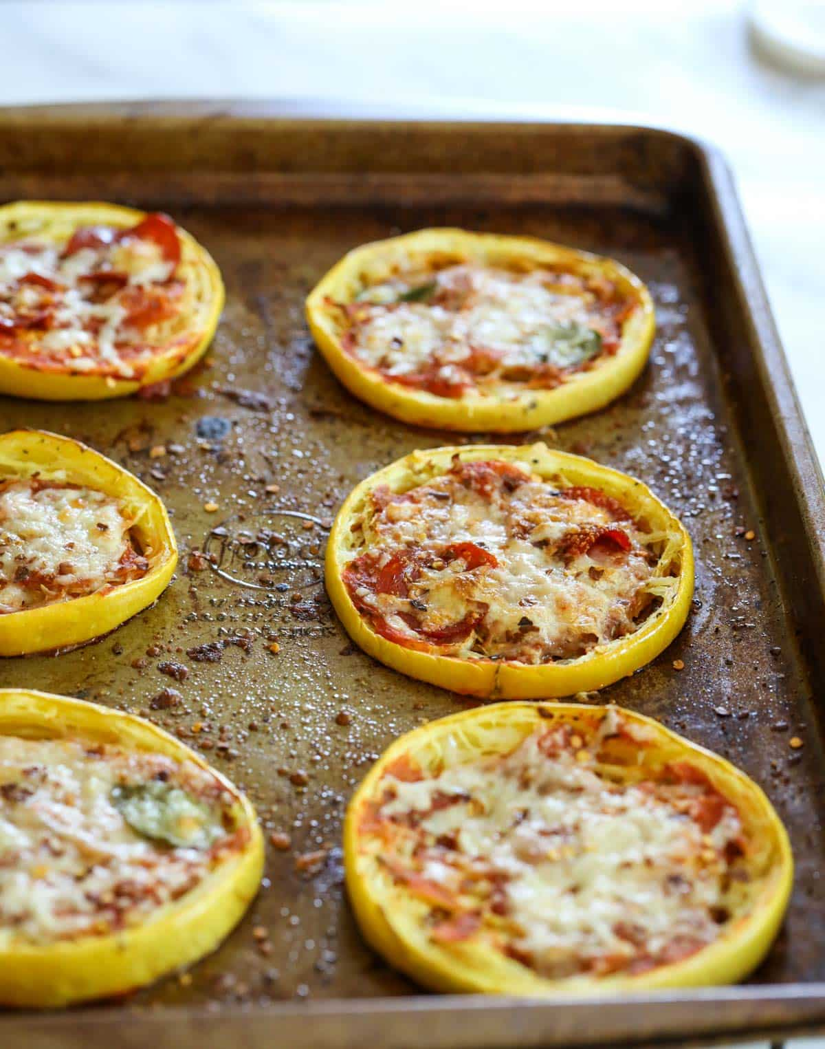 freshly baked squash pizza from the oven on a baking dish