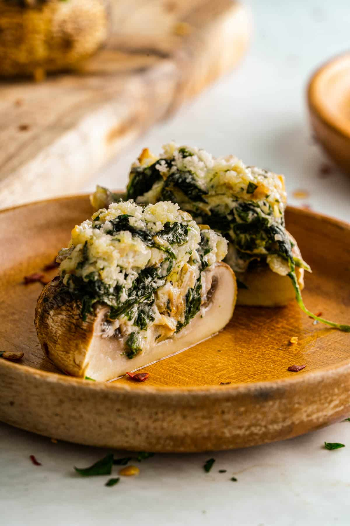creamy spinach stuffed mushroom cut open stuffed with cream cheese and parmesan