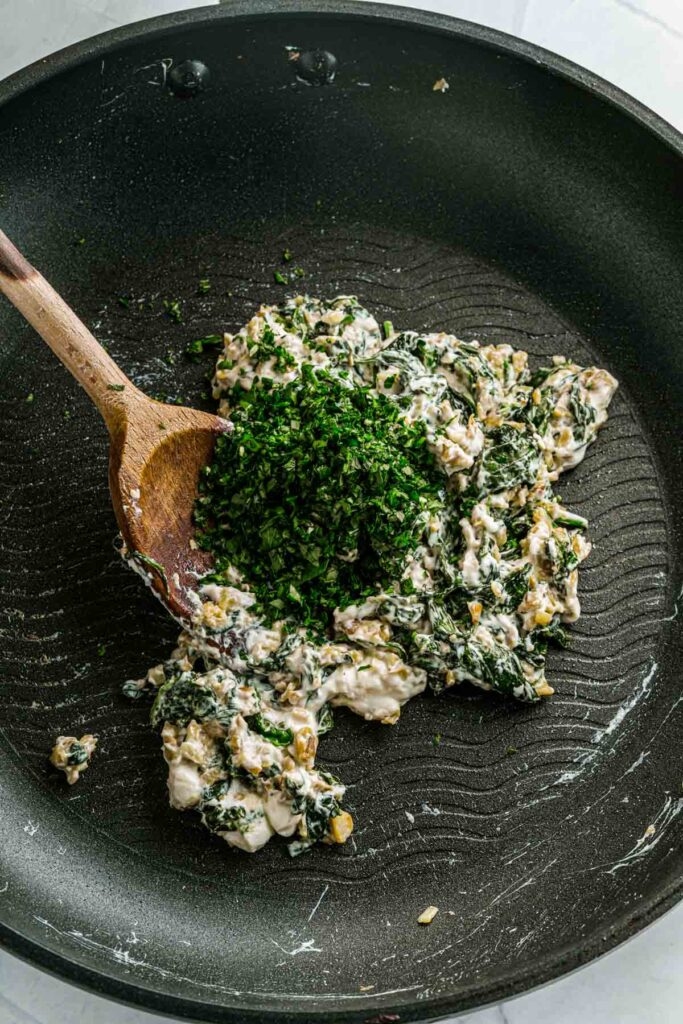 adding fresh parsley