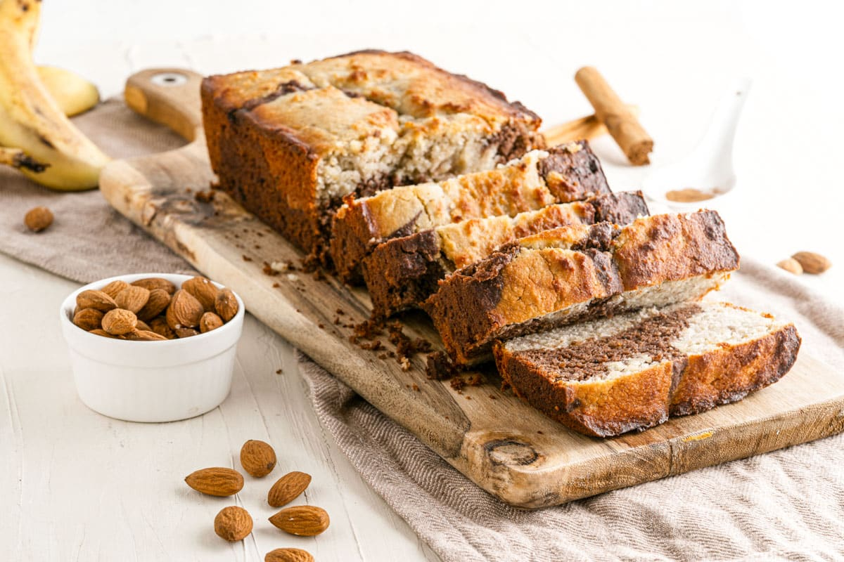 loaf of banana nut bread with almonds