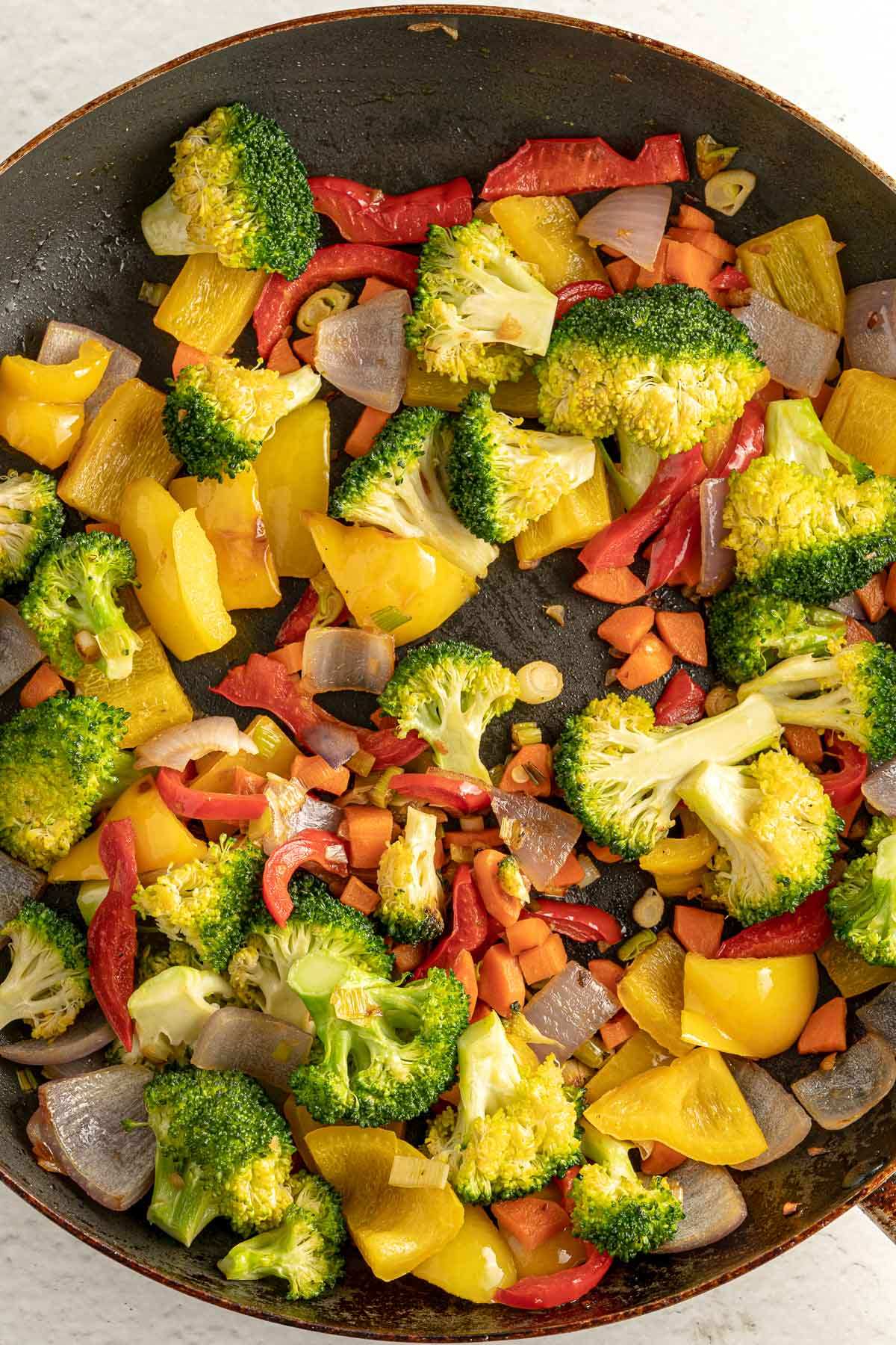 veggies and soy sauce in a pan