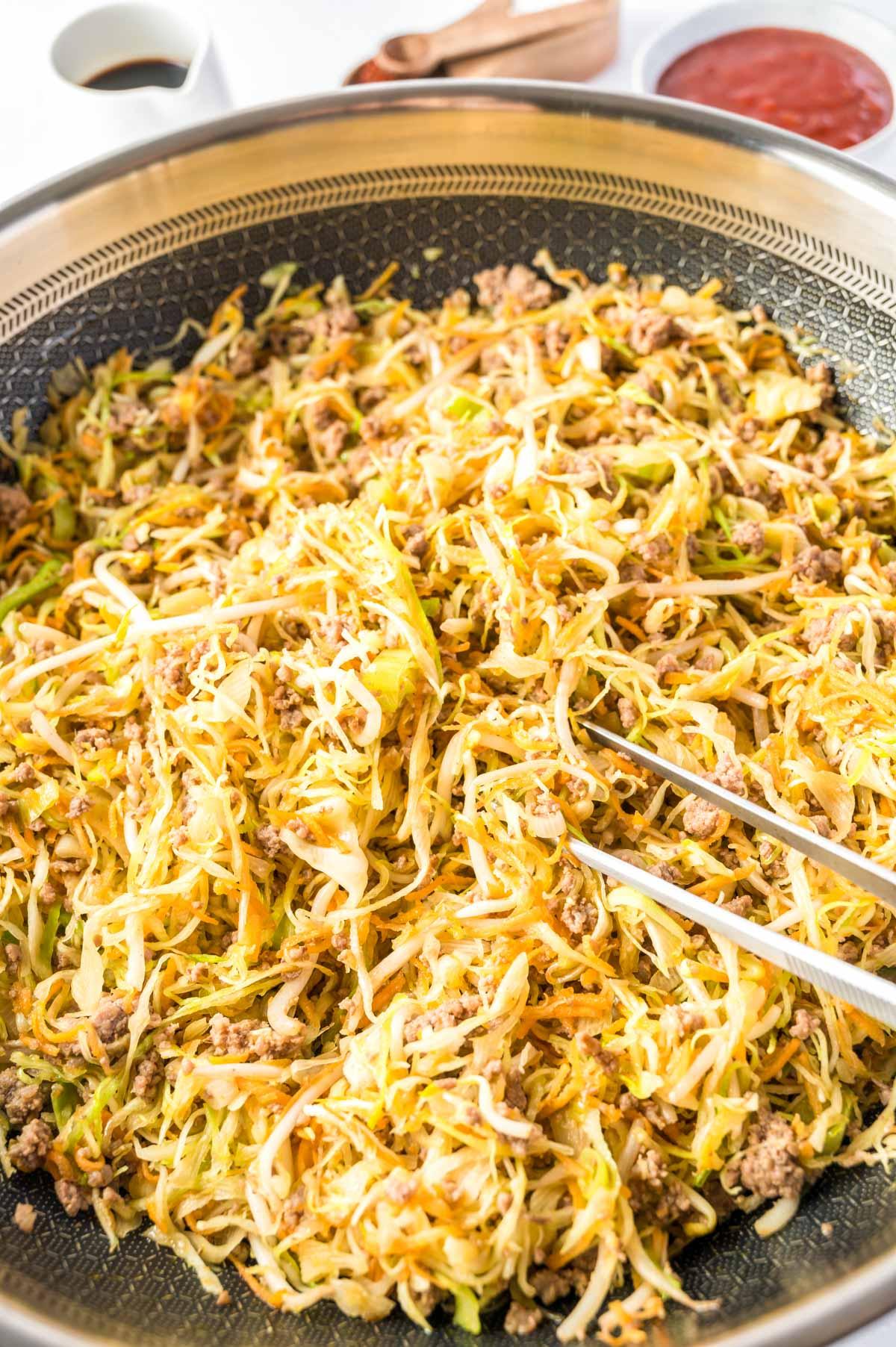 egg roll casserole ingredients in a wok