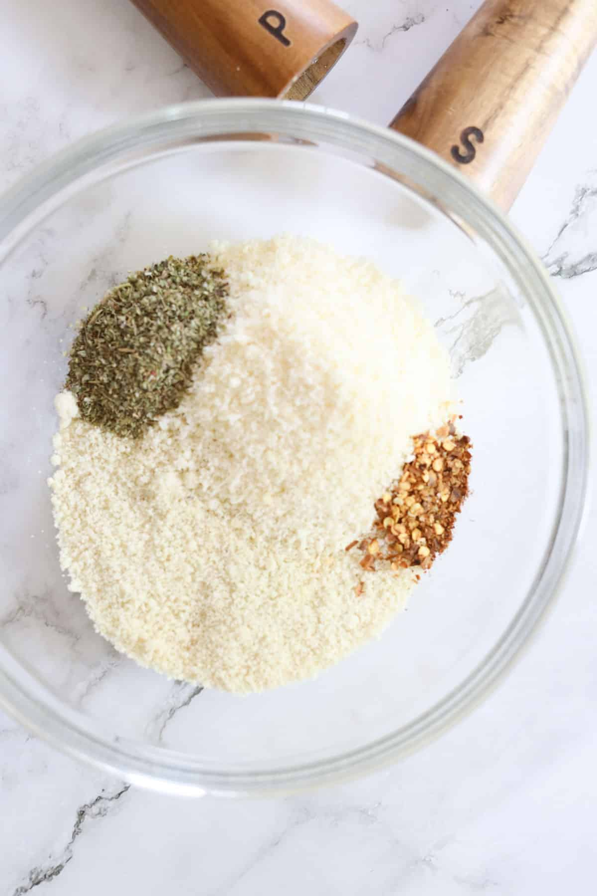 adding dry bread crumb ingredients to a bowl