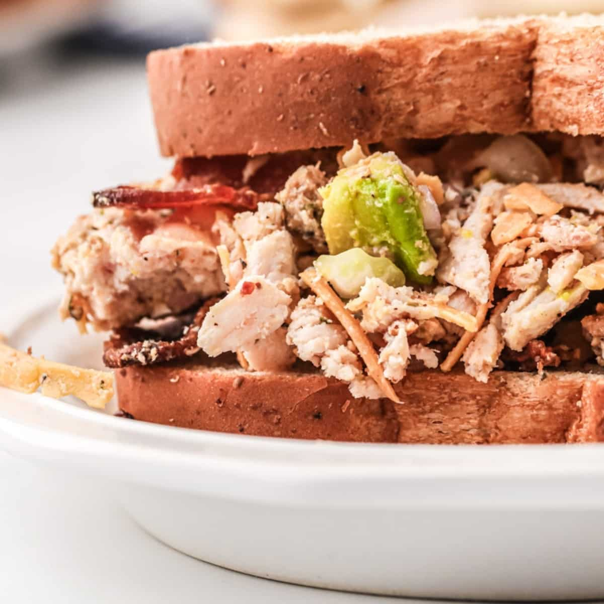 chicken salad sandwich with keto ingredients bacon and avocado