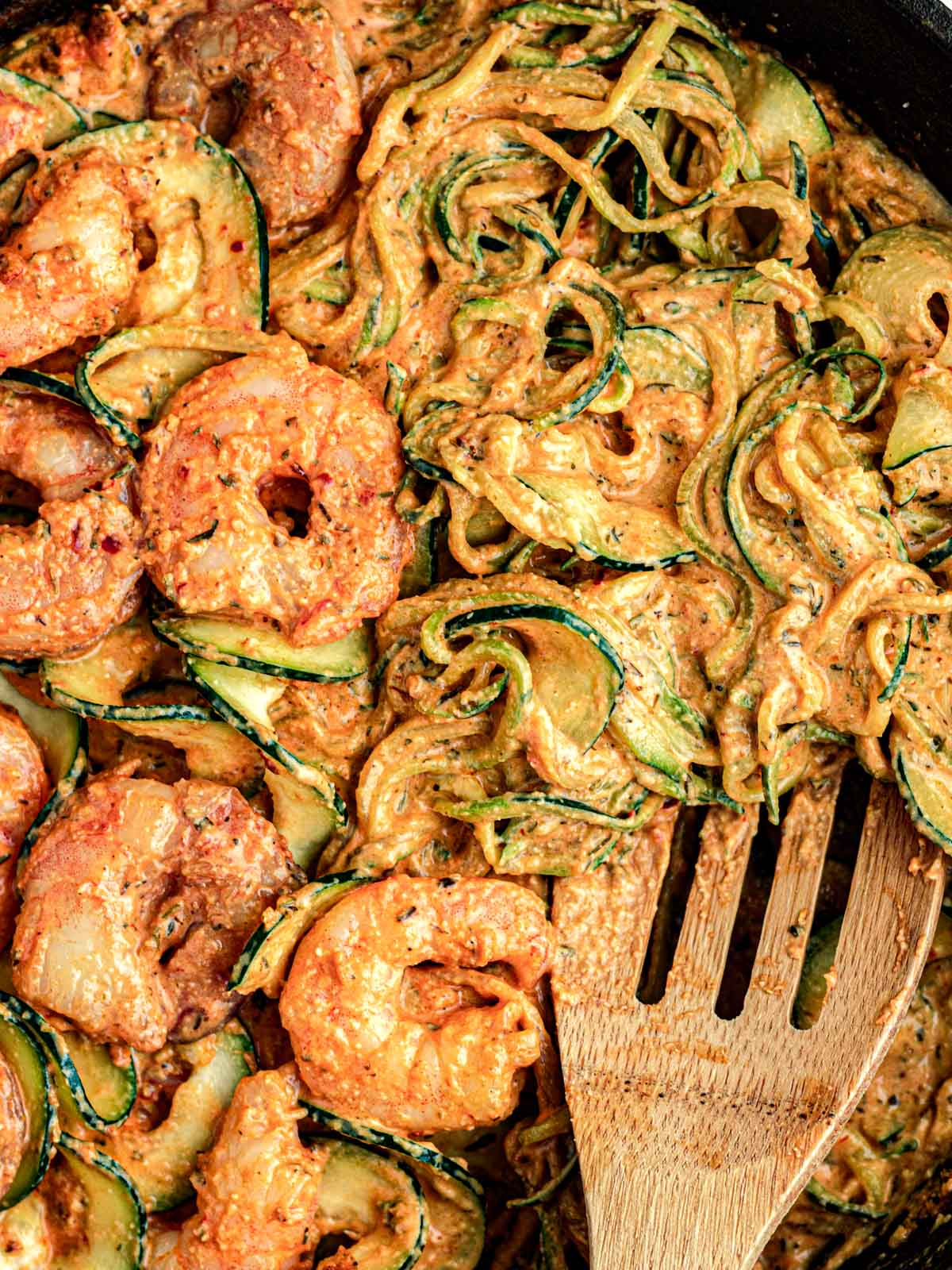close up of shrimp with creamy zucchini and spices