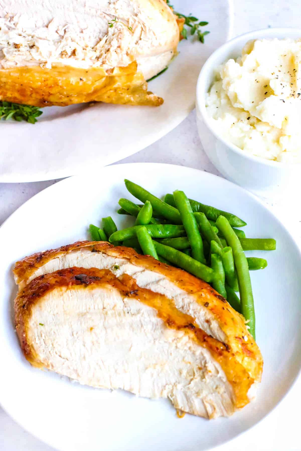 turkey slices, green beans and mashed potatoes