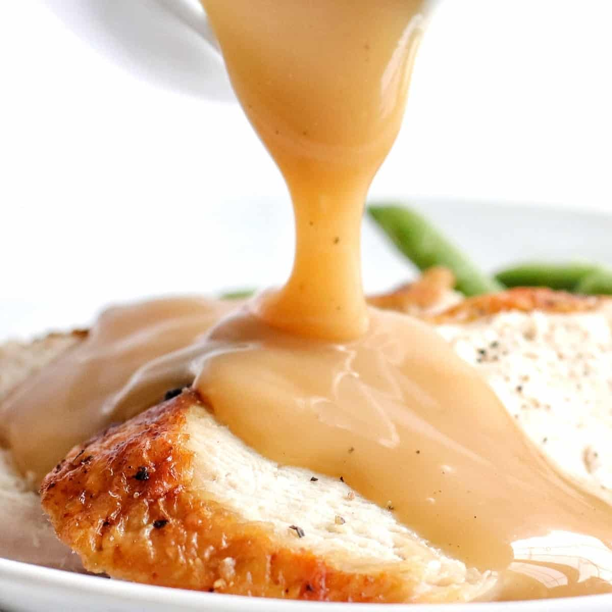 air fryer turkey slices with gravy being poured on top