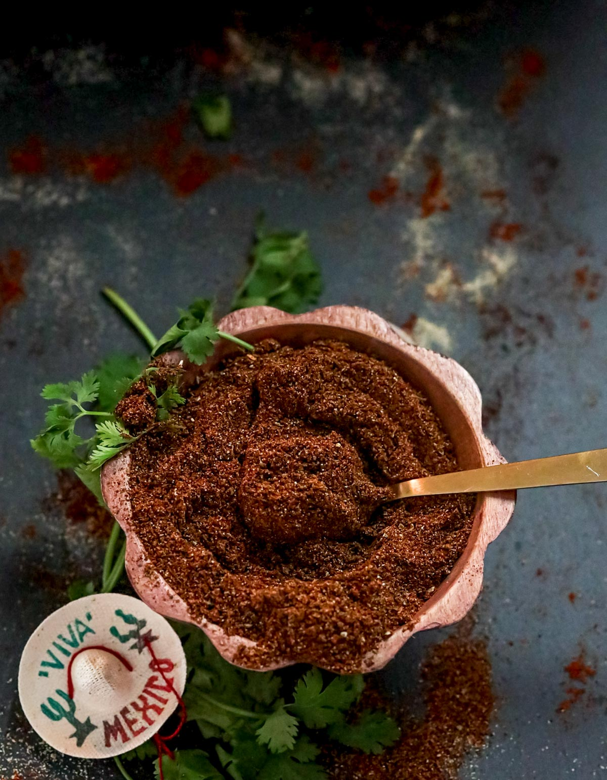 blend of seasonings in a bowl with a spoon