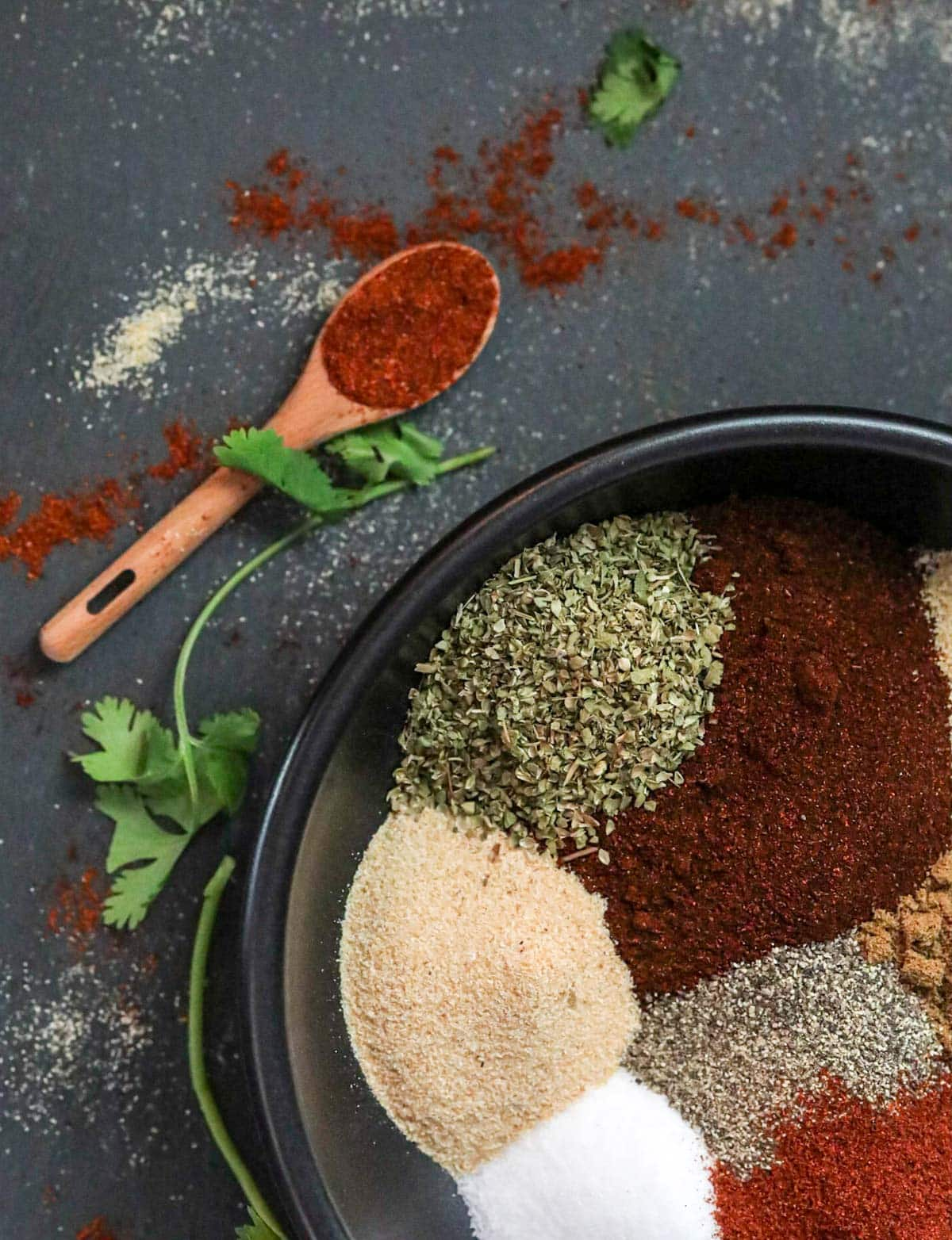 mixing seasoning blend together in a large bowl