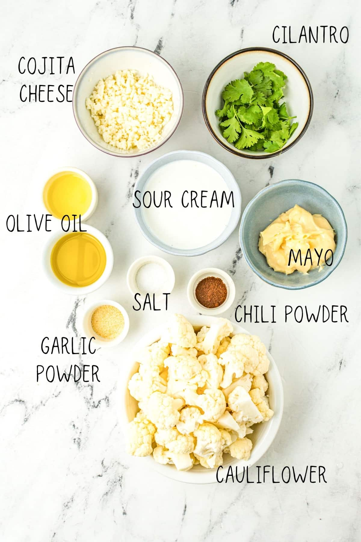 street cauliflower ingredients: olive oil, garlic powder, chili powder, mayo, sour cream, salt, cilantro