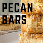 pecan cheesecake bars stacked in a pile