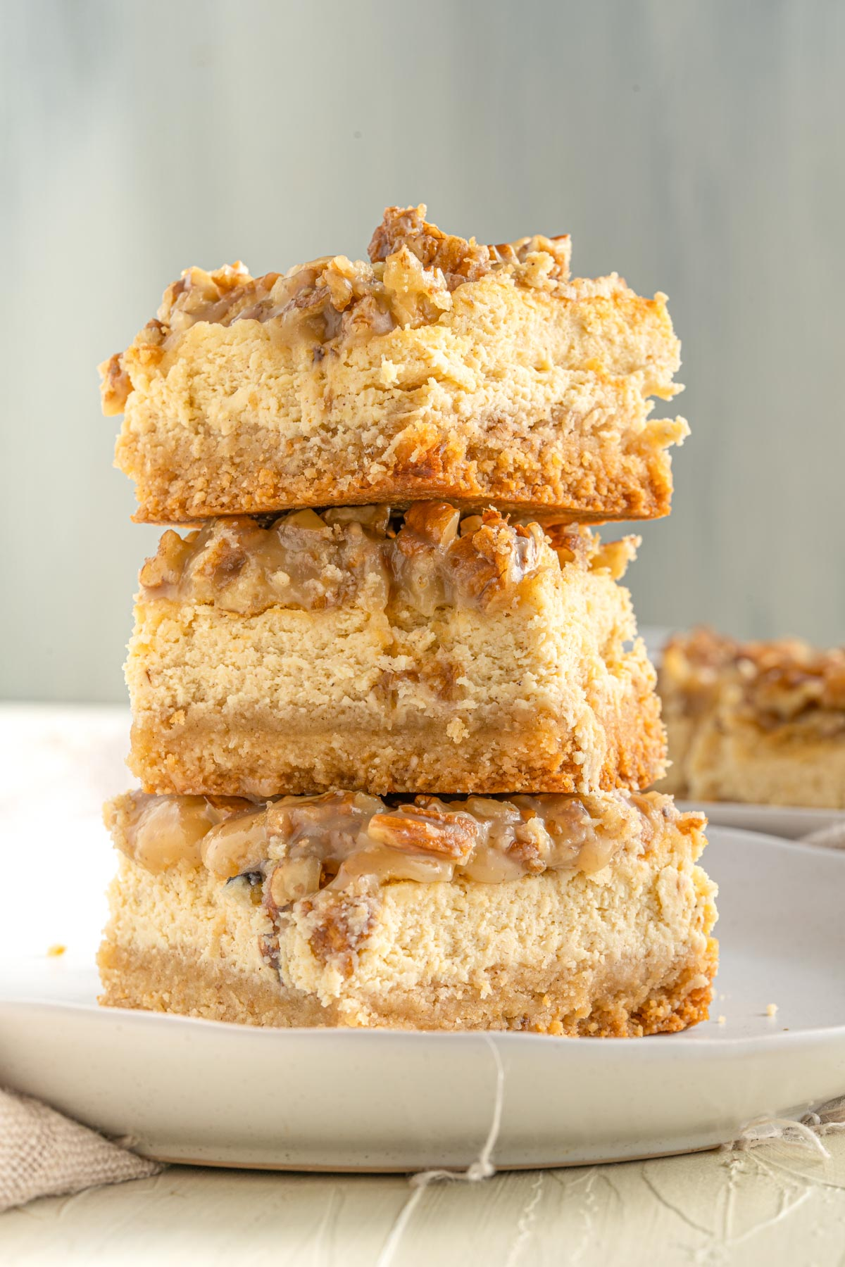 stacked pecan cheesecake bars showing the rich creamy insides